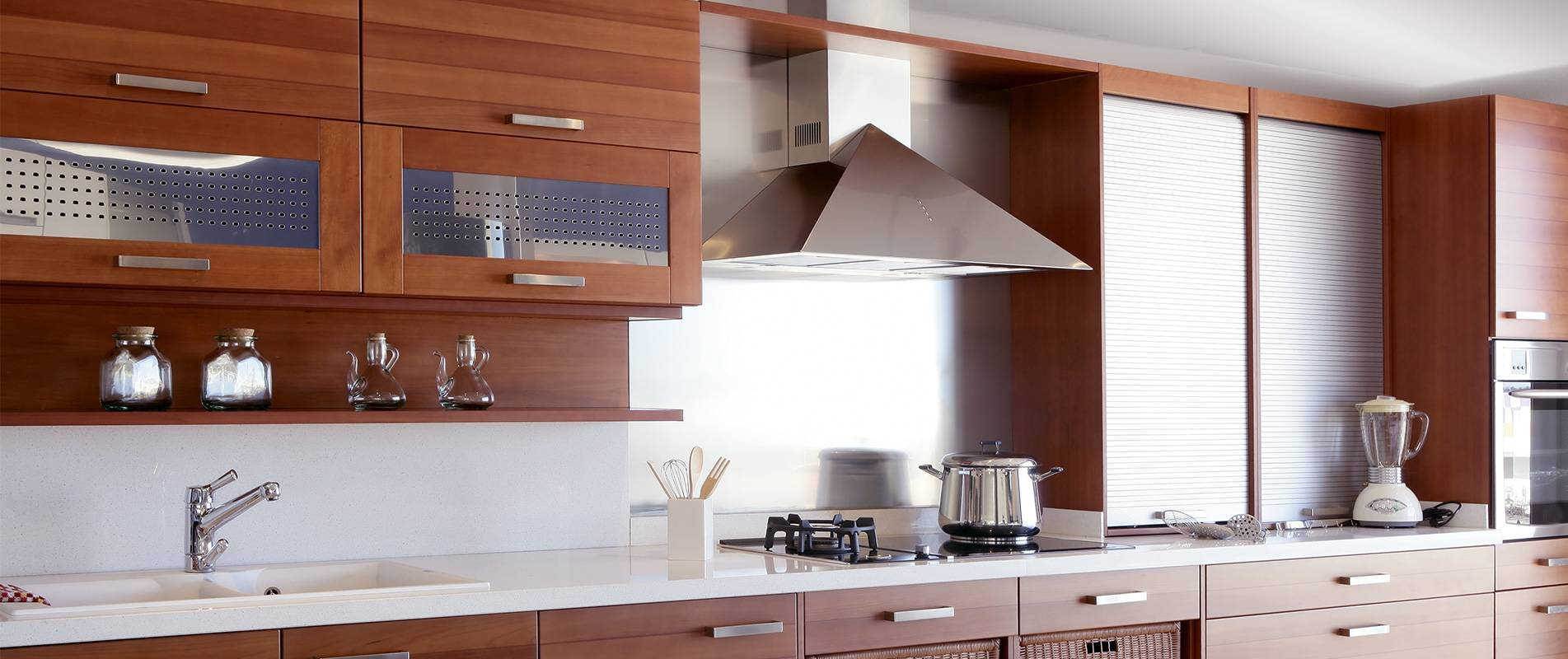 modern well lit kitchen with smooth wooden finish