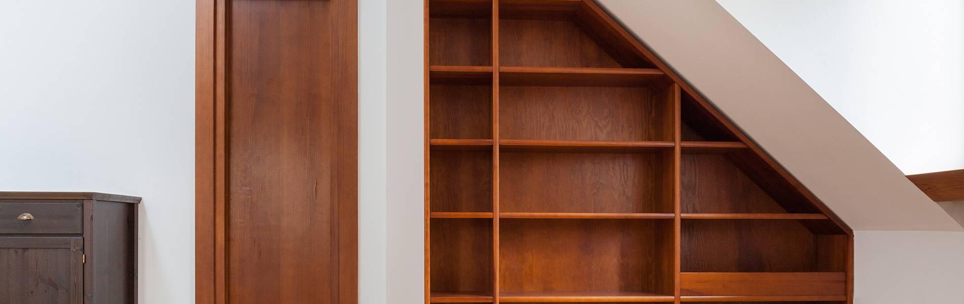 wooden shelf unit in top floor room of house joinery