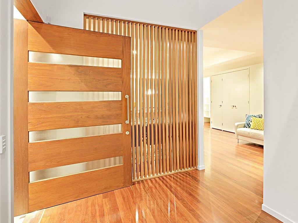 modern wooden door open to living area
