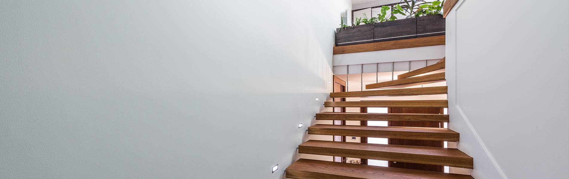 modern floating staircase in white home