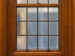 traditional window with large wooden window frame
