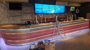 new wooden pub till with neon strip lighting