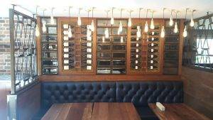 wine cabinet with red wine bottles