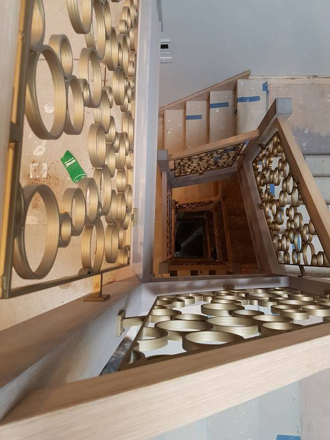 oak staircase with circle panel detailing