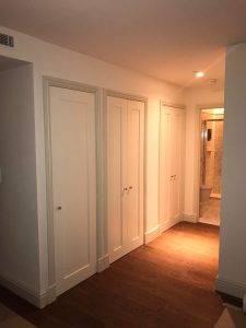 wooden door in wooden walk in wardrobe