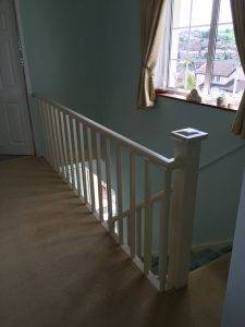 white banister on old staircase