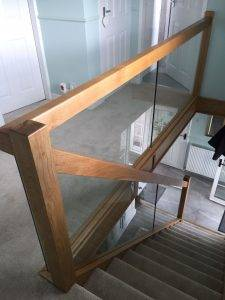 modern wood staircase with glass panels