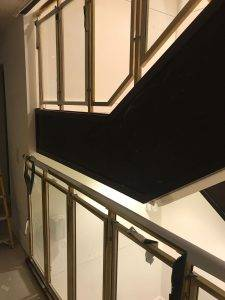 wooden staircase with glass balustrades