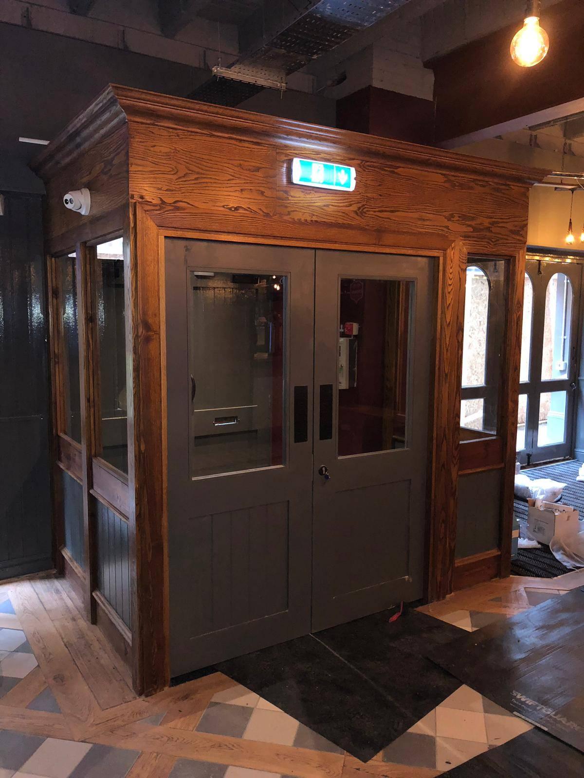 wooden door installation in pub
