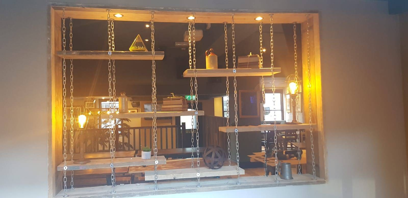 wooden bar with chained wooden shelves