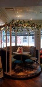 new wooden frame around restaurant seating area
